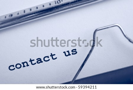 blue toned typewriter detailed closeup typing text contact us