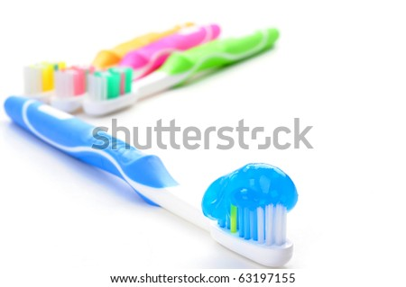 Blue toothbrush loaded with toothpaste on a white background.