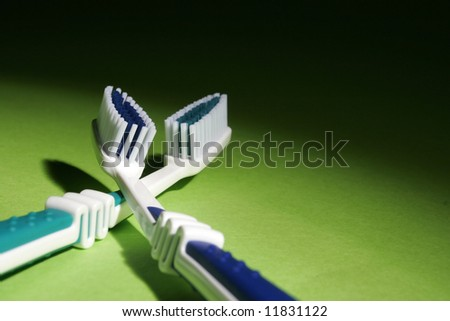 Blue toothbrushes on green background