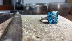 Blue topaz ring on table jewellery making