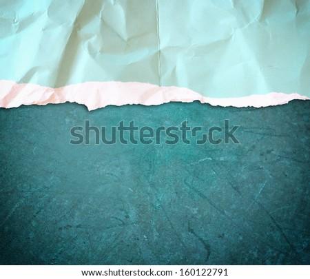 blue torn paper over blue grunge background