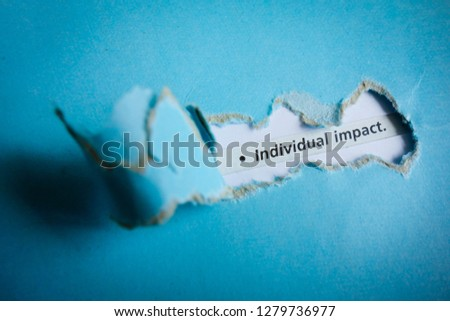 Blue torn paper with text individual impact