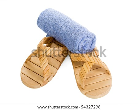 Blue towel on wooden sauna slippers