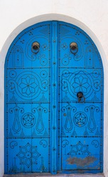 Blue Traditional door with arch from Sidi Bou Said. Tunisian culture and architecture