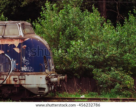 blue train in the woods   urban ...