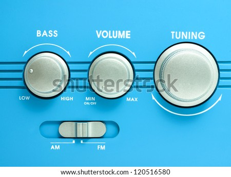Blue transistor radio button ,tuning, volume, bass equalizer