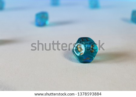 Blue transparant dice macro photo