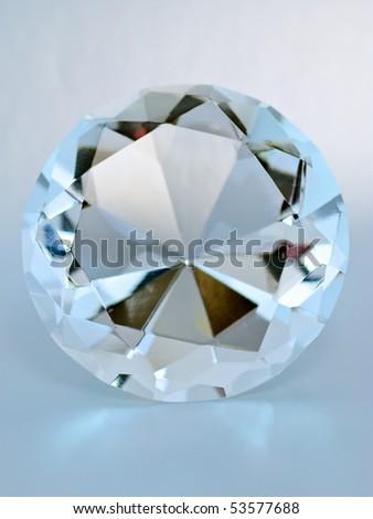 Blue transparent round gemstone, front view