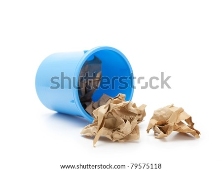 Blue trash can on it's side with crumpled paper spilling out. Isolated on white.