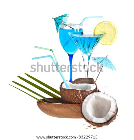 Blue tropical cocktails with coconuts in a wooden bowl isolated on a white background