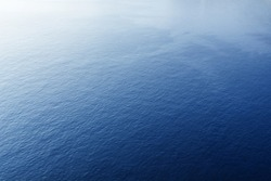 Blue tropical sea surface with waves and ripples. View from plane