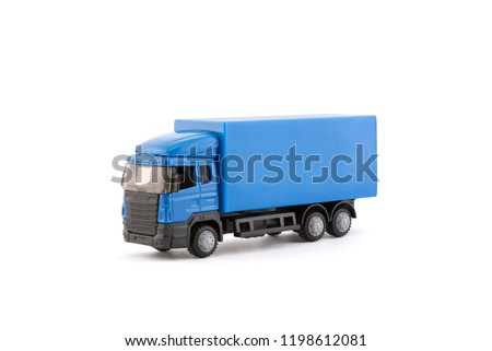 Blue truck miniature on white background