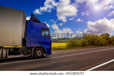 blue truck on the asphalt rural road. Traffic on the highway. image for background. concept about transportation #445304197