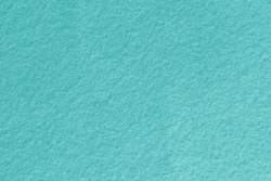 Blue turquoise felt texture background. Surface of fabric texture in blue color.