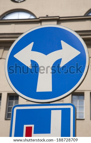 Blue Two Directions Traffic Sign in Urban Setting