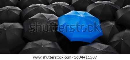 Blue umbrella stand out from the crowd of many black umbrellas - being different concept - 3D illustration Stock photo ©