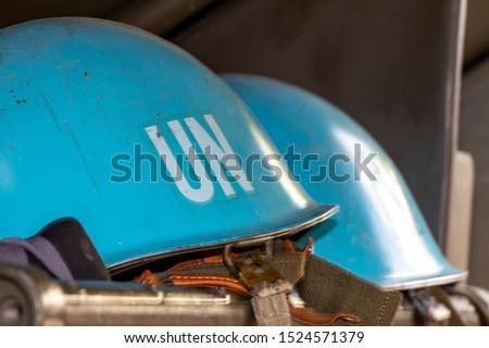 Blue UN helmets waiting for their deployment.