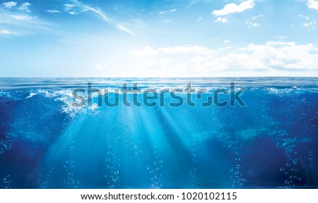 Photo of  BLUE UNDER WATER waves and bubbles