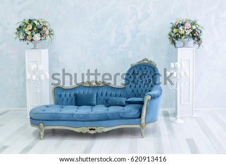 blue vintage sofa in white room....