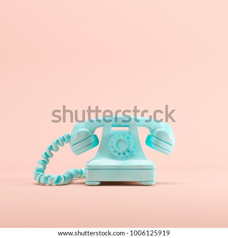 blue vintage telephone on pink...