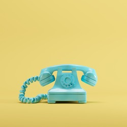 Blue vintage telephone on yellow pastel color background. minimal idea concept.