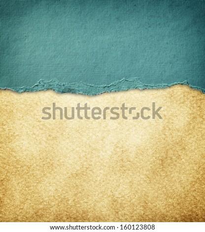blue vintage torn paper over grunge paper texture.