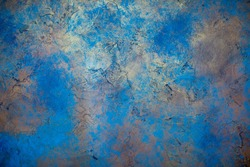 Blue wall background with abstract spots. Beautiful pearly texture, abstract wall surface background, vintage surface texture with copy space, unusual spotty surface.