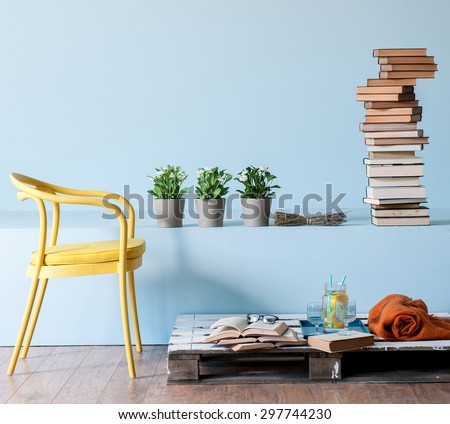 blue wall interior style with yellow chair