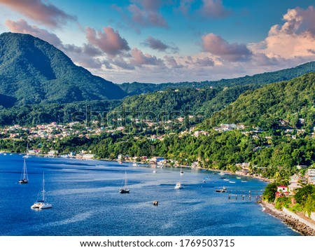 Blue Water and Green Hills of Dominica in the Caribbean Stockfoto ©