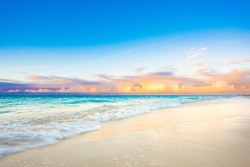 blue water and pastel clouds at sunset on caribbean beach vacation