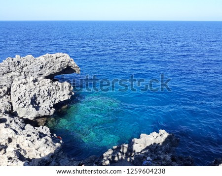 Blue water and rocks in the summer mediterranean #1259604238
