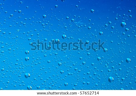 blue water bubbles on the window for background