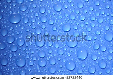 blue water drops on glass - stock photo