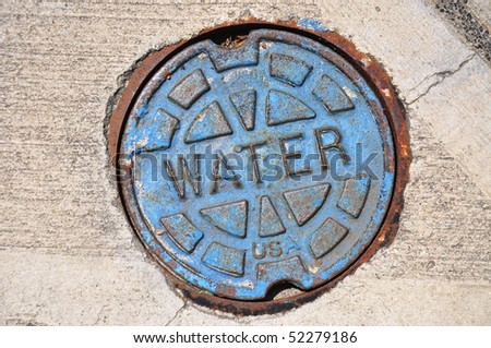 Blue water main cover on street