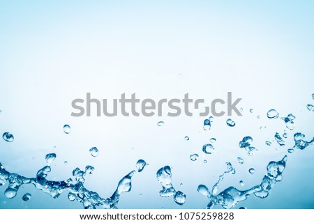 blue water splash on blue background for abstract water concept