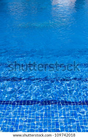 blue water surface background in outdoor pool near villa