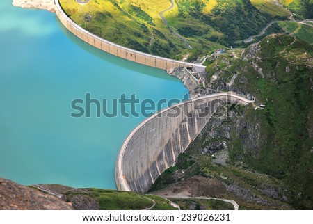 blue water tank with a concrete dam
