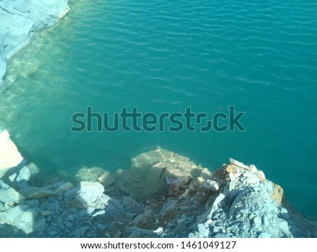 Blue water with clear and clear stone