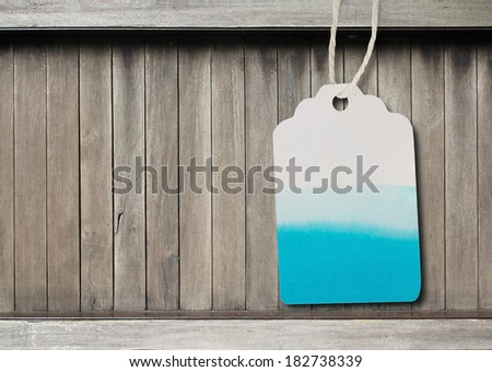 Blue watercolor  label  paper  on  brown wood background