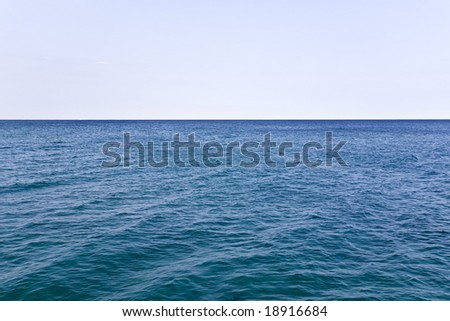 Blue Waters of Wide Open Ocean and Pure Clean Sky Background