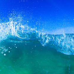 Blue wave breaking into a tube or barrel