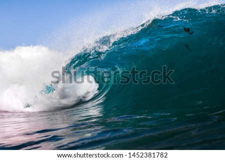 blue wave crashing on a shallow reef  #1452381782