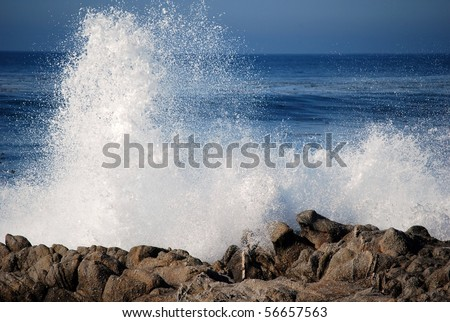 Blue waves crashing on a rocky shore