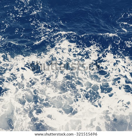 Blue waves of a raging sea. Abstract background.