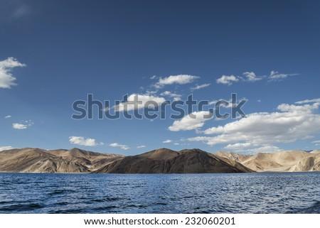 Blue wavy surface of high mountain lake #232060201