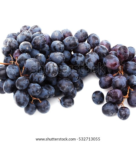 Blue wet Isabella grapes bunch isolated on white background as package design element #532713055
