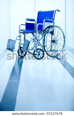 Blue wheelchair at the entrance of a hospital