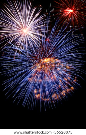 Blue white and red fireworks on dark night sky background
