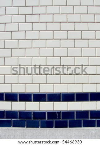 blue white tile pattern on a wall