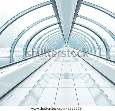 blue wide spacious corridor in contemporary airport walkway